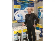 "Television celebrity Howie Mandel tells visitors at Lowe's that the new American Standard ActiClean self-cleaning toilet features easy ""press of a button""¬ù operation for bowl scouring without the brush. (PRNewsFoto/American Standard Brands)"